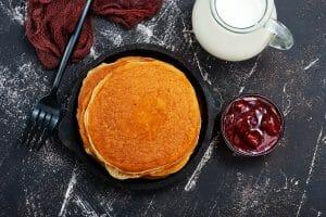 Pancakes with jam and milk
