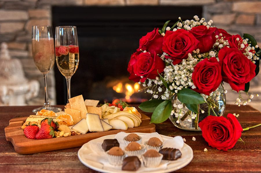 Anniversary Package: fruit & cheese board, flowers and champagne