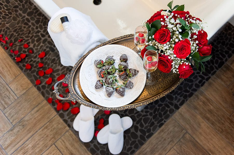 Romance Package: chocolate covered strawberries, flowers and champagne